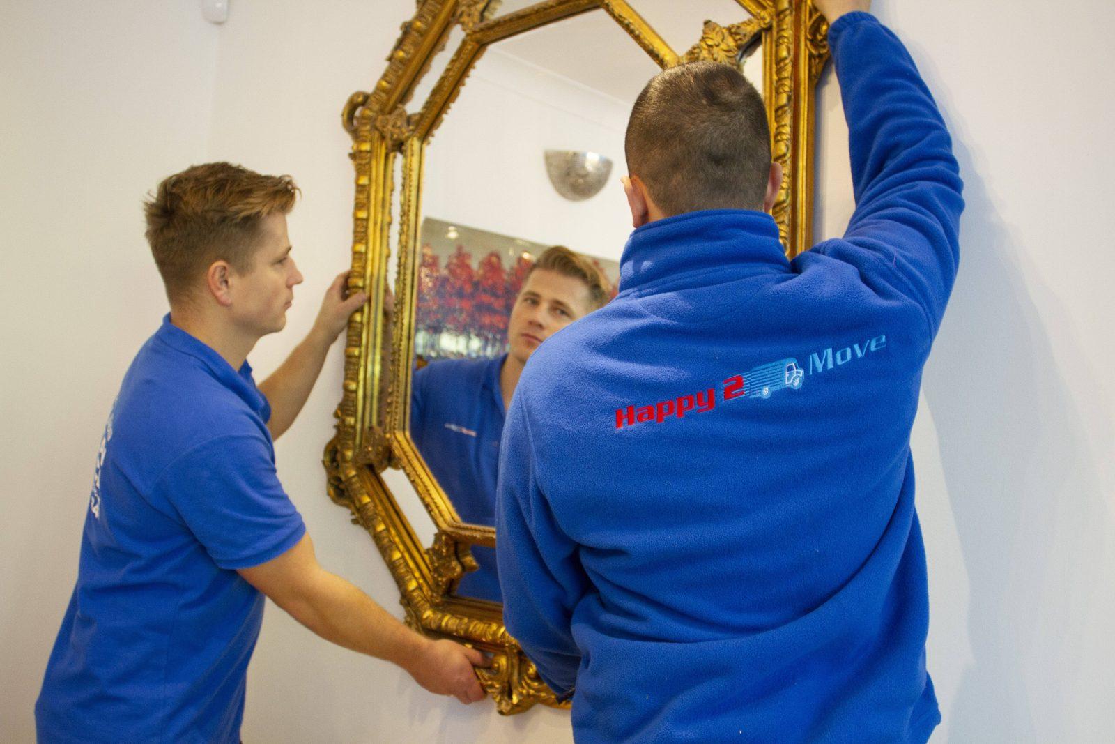 Happy2move staff moving gilt mirror
